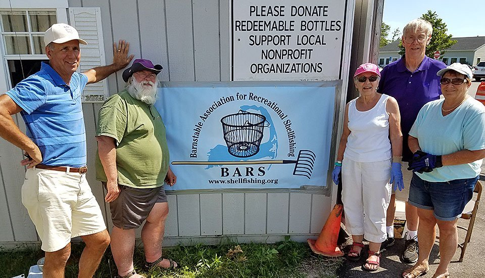 BARS volunteers at the bottles and cans recycling shed at the Barnstable Transfer Station